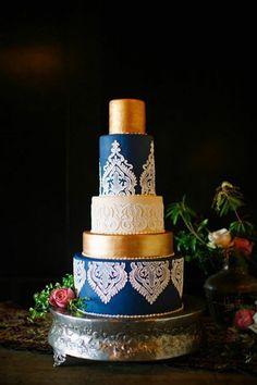 Royal blue and gold wedding cake / Beauty and the Beast theme. Would incorporate…