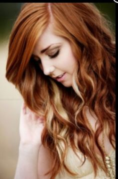 Red hair with blonde peekaboo highlights. Perfect for summer!