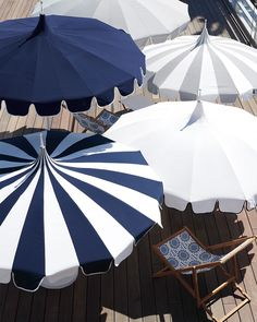 We love the old-school glamour of this pagoda-style design and playful look of the scalloped edges. A weighted base (sold separately) keeps the umbrella steady, even in shifting seaside breezes. Blue Umbrella, Outdoor Umbrella, Under My Umbrella, Beach Umbrella, Umbrella Art, Outdoor Rooms, Outdoor Living, Outdoor Decor, Pool Umbrellas