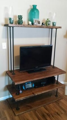 DIY industrial style entertainment center. Made with black steel plumping pipes and 2x12 framing lumber for about $125.