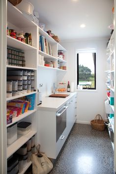 The walk in pantry offers storage space, an additional sink, and a window on the wall. Open compartments make grabbing ingredients or equipment super easy!