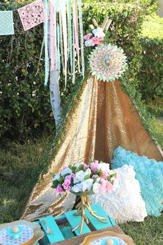 Gold shimmery fabric was used to construct this sparkly boho chic teepee. See more details on the blog! LAURA'S little PARTY: Boho Themed Sweet 16 Party| Party Ideas