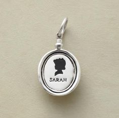 "SILHOUETTE CHARM -- Handcrafted of sterling silver. Boy or girl silhouette with name of up to 8 letters for engraving. 3/4""L."