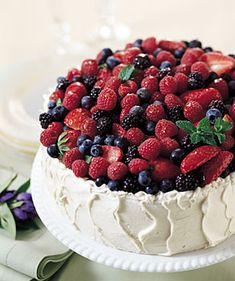 Cannot WAIT to make this Mixed-Berry Chiffon Cake with Almond Cream Cheese Frosting from Bon Appetit!