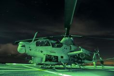 An AH-1Z Viper with Marine Medium Tiltrotor Squadron 161 (Reinforced), 15th Marine Expeditionary Unit, sits aboard the USS Anchorage (LPD 23) during Amphibious Squadron/Marine Expeditionary Unit Integration Training (PMINT) off the coast of San Diego March 2, 2015. The pilots of VMM-161 (Rein) practiced take-offs and landings at night to maintain proficiency aboard ship. (U.S. Marine Corps photo by Sgt. Jamean Berry/Released)