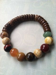 Unisex/Men's stretch Bracelet I made for hubby.  #swag #gemstones #boybeads #armparty.  Others for sale on my website www.mynaturalstate.storenvy.com