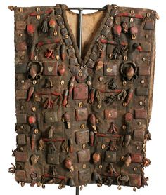 Africa | Vest from a Shamanic Medicine Man from Nigeria | Woven canvas structure with several different talismanic containers, mirrors, metal and  shells affixed to it