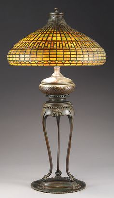 A Tiffany Studios Chinese Tyler table lamp consisting of a geometric pattern over a half moon band, all in dichroic glass that would change color when lit.