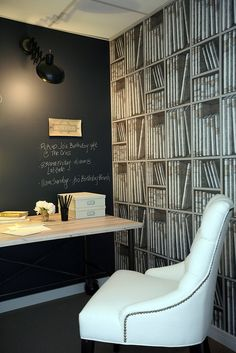 Chalkboard paint adds drama and functionality to a home office.  Love the library wall paper aswell.