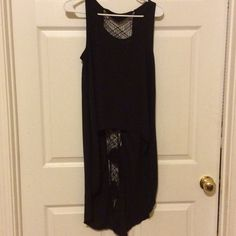Beautiful high low black blouse by free people Beautiful black sleeveless Hilow blouse with crochet all the way from the neckline to the hemline in the middle of the back of the shirt. Made of polyester this is in excellent condition and is truly a unique blouse. Free People Tops