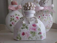 Items similar to Pretty beaded perfume bottle painted with pink roses and pearls. on Etsy