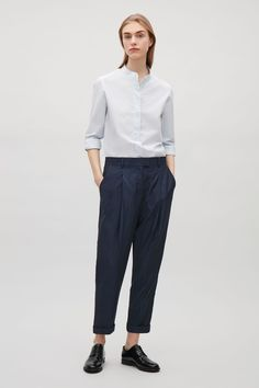 COS image 4 of Relaxed pleated trousers in Indigo