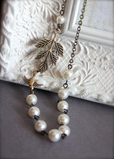 An Oxidized Brass Leaf, Swallow Bird, Ivory Pearls Necklace. Bridesmaid Gift. Bridal necklace. maid of honor.. $29.50, via Etsy.