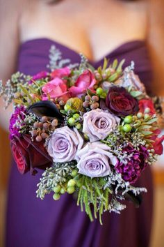 Jewel Tone Bridesmaid's Flowers Including Purple Florals, Hot Pink Roses, Lavender Roses, Red-Violet Roses, Aubergine Callas, Green Hypericum Berries, Silver Brunia, & Other Mixed Coordinating Florals & Foliages****