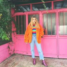 31 Perfect Looks To Copy This December #refinery29 http://www.refinery29.com/december-outfit-of-the-day-ideas#slide-11 Turning yourself into a walking ray of sunshine (with a furry coat, rainbow-striped turtleneck, and glittery purple boots) can turn the even the darkest days around instantly....