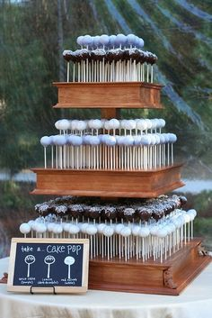 "Adorable wedding cake pop display!  Loving the ""key"" on the chalkboard so guests can choose their favorite flavor."