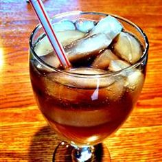 Peachy Keen Long Island Iced Tea (In lg ice-filled glass, mix 1oz each - peach schnapps, vodka, gin, gold tequila (e.g. Sparkle Donkey), white rum, and 3oz sweet&sour mix. Top with splash of cola to taste. Stir)