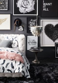 Create a strong focal point with a gallery wall of art in a rich range of shapes, textures and tones.