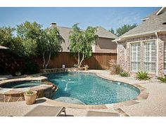 Nice basic pool and spa with stone and aggregate patio from Realtor.com®