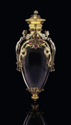 French rock crystal perfume flask mounted in gold with applied gemstones and classical figures - France, c1870.