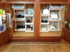 Organize your bathroom cabinet with stackable bins to maximize space from http://www.alejandra.tv