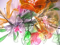 Gelatin flowers are so cool! All you need is some wire, gelatin, & food coloring to make flowers, butterflies, & more!