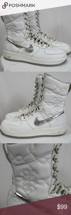 """Nike 9 Air Force 1 High Top 6"""" White Retro VTG Nike women's 9 Air Force 1 High 6"""" White silver 314389-101 high tops retro vtg. These are amazing and one of a kind! Back of right shoe the little pull on loop has come off one side - stays to the top so you can't see it unless you pull it back like I did for the photo. Minor signs of wear and a few nicks/spots but nothing seriously notable. Nike Shoes Sneakers"""