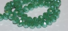 23 pcs 8x6mm Opaque Green Luster Rondelle Glass Crystal Beads by RainandSnowBeading on Etsy
