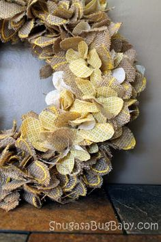 Another really cute burlap wreath, this one looks time consuming, but probably worth it-it's cute!