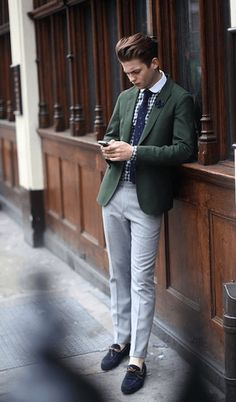 Green blazer with grey slacks, large gingham check shirt, and solid blue tie.