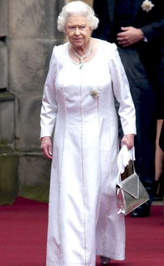 2012 from Queen Elizabeth II's Royal Style Through the Years  The Queen—in a pearl-lined long-sleeve dress—attended the installation of Prince William as a Knight of the Thistle in Edinburgh, England.