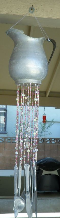 Cutlery on pinterest wind chimes forks and yard art for How to make a windchime out of silverware