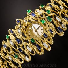 Omega Yellow Gold Gem Set Free Form Bracelet Wristwatch circa 1960s | From a unique collection of vintage wrist watches at https://www.1stdibs.com/jewelry/watches/wrist-watches/