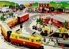 A promotional image depicting several of the train sets from the LEGO Town theme in the 1980s (including sets 7740, 7822, and 7834)