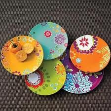 Bold colourful plates to spice up the dinner table. They look there best on & Butterfly plate charger | Tableware Butterflies and Charger