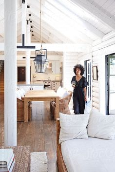 African American woman walking through modern design living room in home