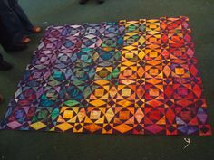 Gorgeous rainbow Storm at Sea pattern quilt -- the stained glass effect is truly stunning!