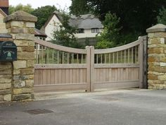 Beautiful driveway gate design. Instead of wood, we'd build it out of aluminum and faux-paint it to look like wood so it would last longer in the Texas heat. Farm Entrance, Driveway Entrance, Wooden Garden Gate, Wooden Gates, Front Gates, Entrance Gates, Front Fence, Front Entry, House Gate Design