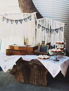 So adorable! Rustic and chic wedding like the back drop :)