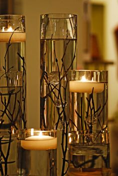 floating candles. branches. nature combined with elegance.
