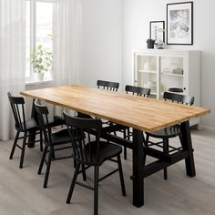 IKEA - SKOGSTA, Dining table, Every table is unique, with varying grain pattern and natural color shifts that are part of the charm of wood.Solid wood is a durable natural material which can be sanded and surface treated when required. Ikea Dining Table, Dining Set, Table And Chairs, Kitchen Tables Ikea, Long Narrow Dining Table, Black Dining Room Table, Room Chairs, Skogsta Ikea, Home Interior