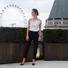 Emma Watson in London for the Beauty and the Beast press tour wearing Carmen March, Burberry, Catbird, and All Blues.