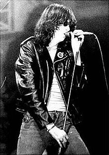 """April 15 2001, Punk pioneer Joey Ramone (Jeffrey Ross Hyman) singer of The Ramones died after losing a long battle with lymphatic cancer aged 49. On November 30, 2003, a block of East 2nd Street in New York City was officially renamed Joey Ramone Place.  Joey Ramone died of lymphoma. He was reportedly listening to the song """"In a Little While"""" by U2 when he died. This was during U2's Elevation Tour"""