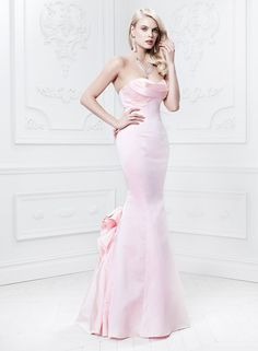 Truly Zac Posen satin Fit and Flare gown with draped and sculpted bodice, $225For information: davidsbridal.com
