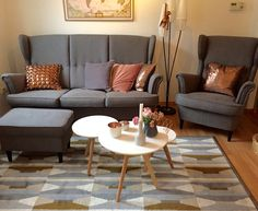 Mid century modern living room with IKEA Strandmon Sofa and copper Decor