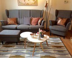 Mid century modern living room with IKEA Strandmon Sofa and copper Decor
