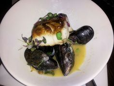Monk Fish with Mussels in a garlic white wine reduction sauce.
