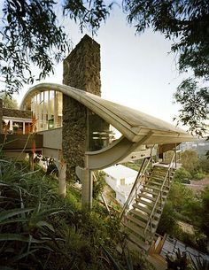 This house on Mulholland Drive, southern California, was originally designed for jazz musician Russ Garcia.  1964. Architect John Lautner,