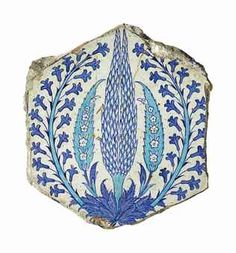 A BLUE AND WHITE IZNIK POTTERY TILE, OTTOMAN TURKEY, CIRCA 1530. Of hexagonal form, the surface painted in cobalt-blue and turquoise on white ground with a central cypress tree issuing from a leafy frond, the cypress surrounded by two smaller turquoise trees each filled with a spray of flowerheads and flanked by a large curling branch of hyacinths.