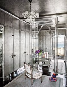 At the San Francisco home of art collectors Norah and Norman Stone, Norah's dressing room—decked out in mirrors and silver wallpaper—is all original; the light fixture is Venetian glass.